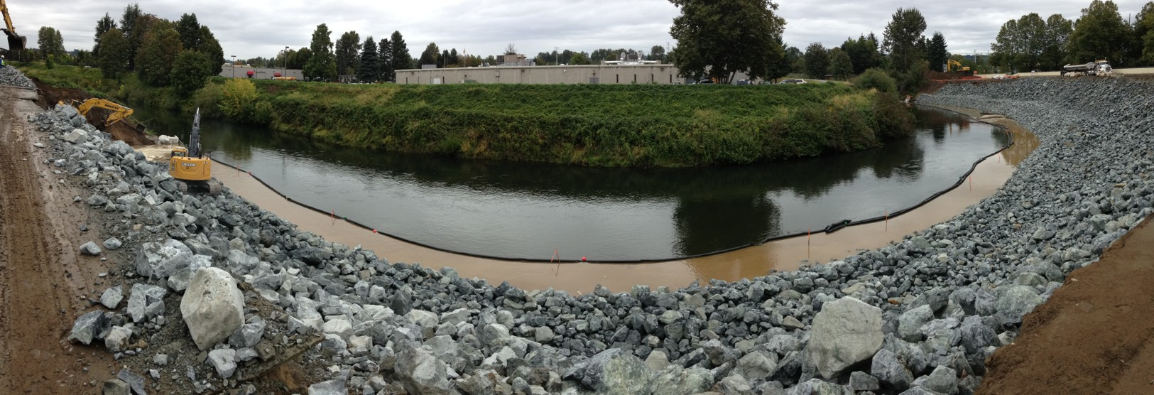 Flexible turbidity curtain protects waterways from construction silt.